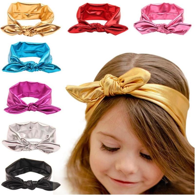 Superleuke haarband met strik glans goud kindermaat