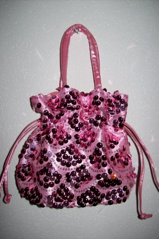 Roze glittertasje met glitterpailletten