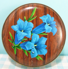Retro blikje blauwe bloemen