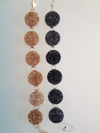 Bow and Crossbones, Glam it Up Glitter Disc Bracelet in Gold or Black.