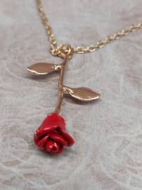 Halsketting kleur coppergold met rode roos