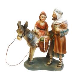 Kg11-6.23 Herder met kindje op ezel