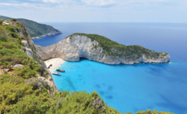 Fotobehang Grieks Strand met Rotswanden