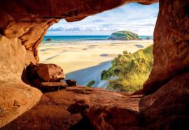 Fotobehang Strand uitzicht vanuit grot