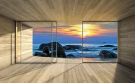 Fotobehang Uitzicht op de rotsen in de zee