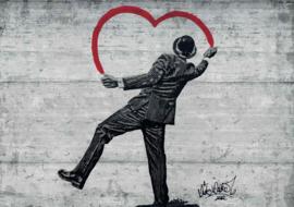 Fotobehang Banksy Graffiti op Betonmuur