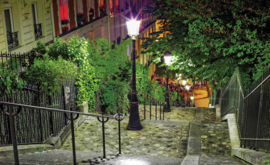 Fotobehang Straat in Parijs bij avond