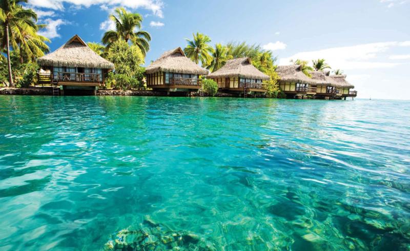 Fotobehang Caribische Zee met Strandhutten