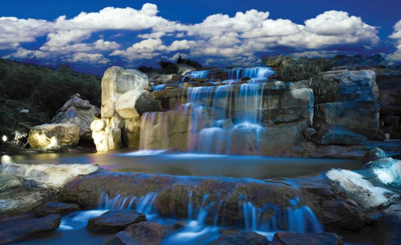 Fotobehang Waterval en Wolken