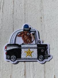Opstrijk applicatie politieauto met hond