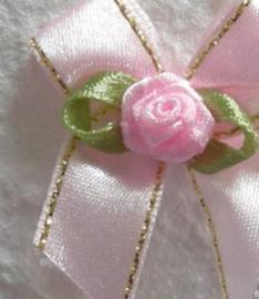 Strikje roze/goud & roosje