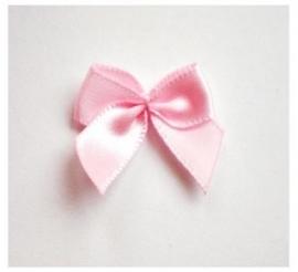 strikje licht roze satijn