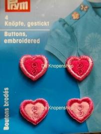 Geborduurde knoopjes hartjes