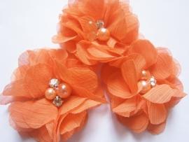 Bloem chiffon met parels & strass oranje
