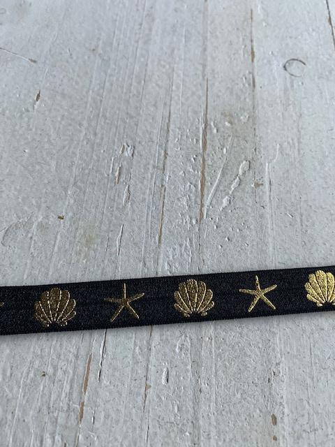 Elastisch haarband zwart met schelp goud