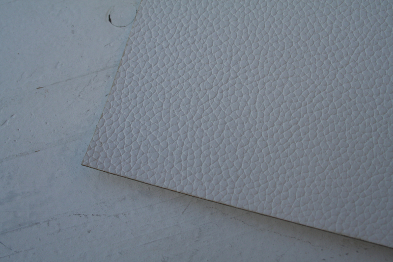 Leer structuur off white