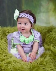 Feestjurk baby lavendel/groen + haarband, maat 62/68