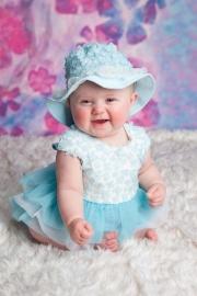 Babyjurk blauw glittertjes + hoed