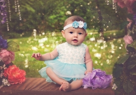 Babyjurk blauw + haarband (mt. 62/68)