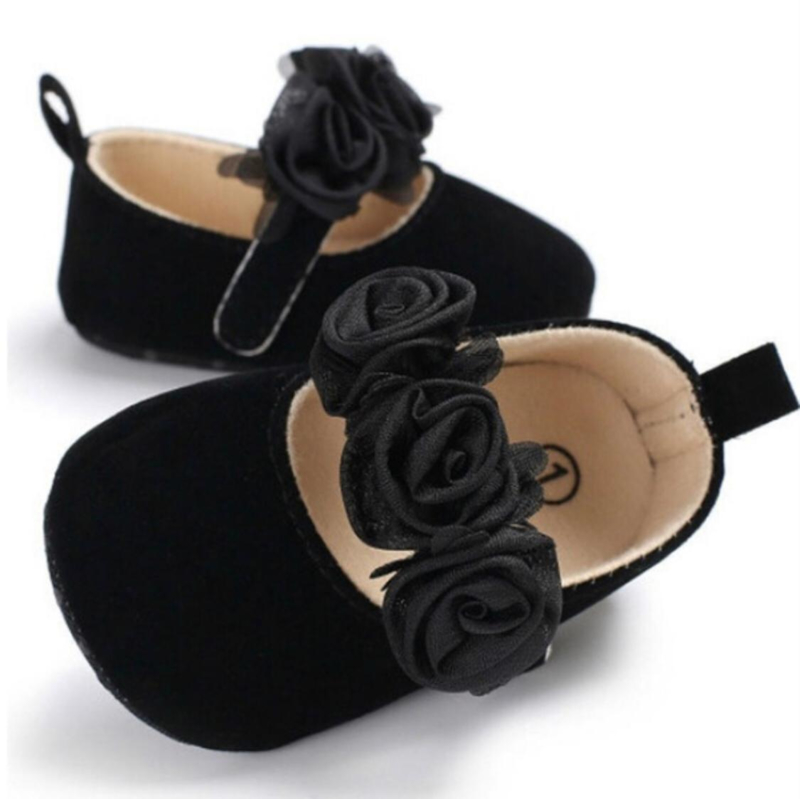 Babyschoen zwarte met roosjes