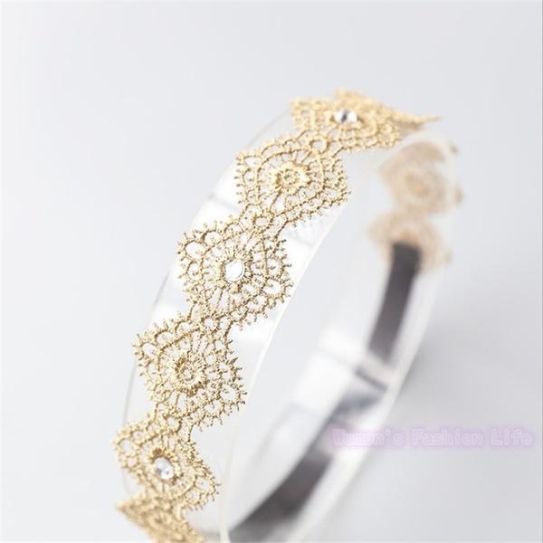 Haarband met goud kant en steentjes