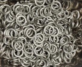 titanium sluitringen ongekleurd 1.2x4.2mm. (machinaal) 100st.