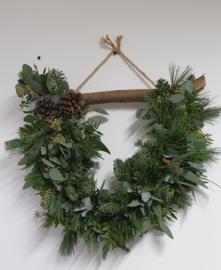 Halve ( kerst)krans aan tak