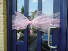 Roze deurstrik geboorte meisje