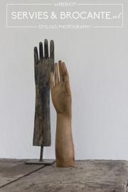 Oude houten hand