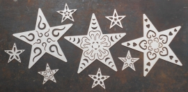 Opengewerkte sterren groot