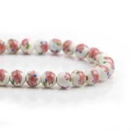 Keramiek kralen met roze bloemen (streng)