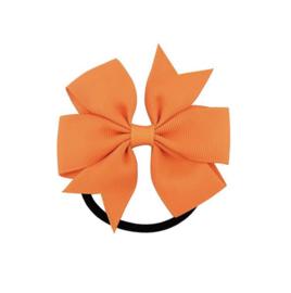 Elastiek met grote oranje strik
