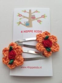 Haarspeldjes met oranje bloem