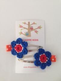 Haarspeldjes met gehaakte bloem rood wit blauw en oranje