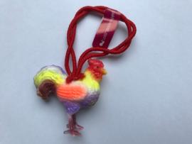 Haarelastiek haan oranje vleugels met rood elastiek