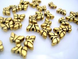 Lief klein vlindertje 8 bij 5 mm antiek goud per 46 gram ongeveer100 stuks