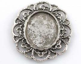 Cabochonzetting antiek zilver 35 bij 41mm binnenmaat 23 bij 18mm per stuk