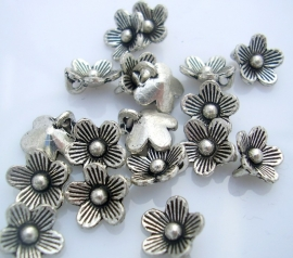 Bedeltje bloem 10 bij 3.5mm per 10 stuks