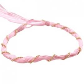 Armbandje twisted licht roze