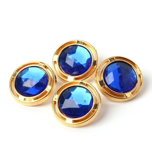 Goudkleurige knoop met blauwe steen