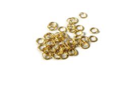 TB.65 - OPEN RINGETJES GOUD / 10 X 1MM