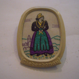 1938-11-5/6 German WHW donation pin. Traditional dress Austria / Ostmark - Niederdonau , woman standing. Woven fabric in metal frame T147.1 (14807)