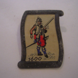 1938-02-5/6 German WHW donation pin. Uniform and history -  Arquebusier 1600. Woven fabric in metal frame T108 (15032)