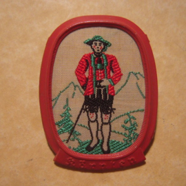 1938-11-5/6 German WHW donation pin. Traditional dress Austria / Ostmark - Kärnten , standing man. Woven fabric in metal frame  T142.1 (12711)