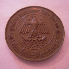 Gau Halle-Merseburg 1936/37 WHW donation pin. We belong together. Brown synthetic 40mm  T029 (15914)
