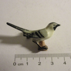 1942-02-28/03-1 German WHW donation pin. Birds of our hometown - White wagtail. Porcelain T463.1 (16390)