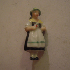 1937-03-20/21 German WHW donation pin. German folk costums - Berchtesgarden woman. Porcelain T075 (14114)
