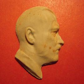 1933-45  Adolf Hitler.   Unglazed porcelain green 36x61mm (9496)