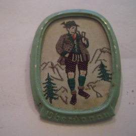 1938-11-5/6 German WHW donation pin. Traditional dress Austria / Ostmark - Oberdonau , man with pipe. Woven fabric in metal frame T148.1 (14882)
