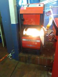 Leveren, installeren, afstellen en opstoken van een Atmos pelletketel